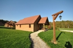 Beautiful and comfortable holiday home in Saint Fargeau en Puisaye, Burgundy, France with communal pool for 4 persons. This resort accommodation is situated in a resort accommodation wit, in a hilly, rural and wooded area, at 200 m from Lac de Bourdon beach, at 5 km from Saint Fargeau and at 0,2 km from Lac de Bourdon. This resort accommodation has 2 bedrooms and 2 bathrooms. The accommodation offers a lawned garden with gravel and trees and a lawned communal garden with gravel and trees. The vicinity of the beach, sports activities, sights and culture makes this a fine holiday home to celebrate your holidays with family or friends and even your pets. Interior of this holiday home, Saint Fargeau en Puisaye