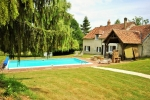 Large and luxury holiday home with private pool and tennis court, in Treigny, Bourgogne, France for a maximum of 15 persons .This holiday home with 2 extra gusthouses is situated in a hilly, rural and woody area and offers a lot of privacy and a lawned and gravel garden with trees.Its tranquility, comfort and the vicinity of make this an ideal holiday home to celebrate your holidays with family or friends and even your pets.Interior, Treigny