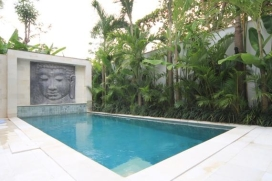On walking distance from the restaurants and shops of Jalan Oberoi, but with the privacy afforded by the secluded location half way of a 50-meters semi-private alleyway, this modern chic three bedroom holiday villa, built in 2011, is located in the m, Seminyak