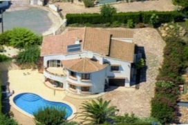 Villa    with private pool, in Benitachell, Costa Blanca, Spain for a maximum of 8 persons.This villa is situated  in a  hilly and residential area. The accommodation has a garden with trees.Interior, Benitachell