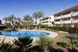 Luxury 2 bedroom ground floor apartment (sleep 4) with private garden and resident's pool in Javea, Costa Blanca, just 400m to the sandy beach. This ground floor 2 bedroom apartment has a large private terrace/garden area and direct access to the resident's pool and gardens so is ideal for families with children who wish to play on the complex unsupervised and who can freely come and go. 2 sunbeds are provided and a parasol keeps you cool while you eat al fresco. This lovely apartment also benefits UK TV, air conditioning and wifi. Located in the heart of the Arenal sandy beach area, near the shops, restaurants and bars, shops and cafés, Golden Beach is ideal for those not wishing to use a car while on holiday. There is a good supermarket just around the corner and just a 5 minute stroll from the sandy beach.  , Javea