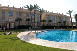 Ground floor 2 bedroom holiday beach apartment with private patio garden and overlooking the pool in Javea, Alicante. This lovely apartment sleeping 4 has direct access to the resident's pool and gardens so is ideal for families with children wanting to keep an eye on them in the pool. Adults can sit on the terrace while the children can play outside with other children. 2 sunbeds are provided and a parasol keeps you cool while you eat al fresco. Being south-west facing it means that you have sun all day until sunset. Located in the heart of the Arenal sandy beach area, near the shops, restaurants and bars, shops and cafés, Golden Beach is ideal for those not wishing to use a car while on holiday. There is a good supermarket just around the corner and just a 5 minute stroll from the sandy beach.  , Javea