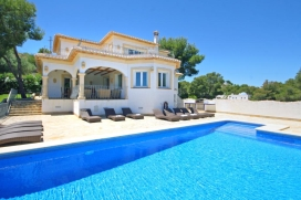 Luxury holiday villa in Javea - Costa Blanca, with private swimming pool for 10-12 people.Magnificent 3 storey villa located on a hillside and offering views across the wooded surroundings. The villa is close to the idyllic bay La Granadella. With th, Javea