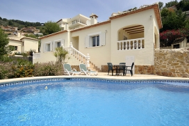 Holiday rental villa on the Costa Blanca, Spain, with private swimming pool for up to 6 people . Luxury villa, situated in the foothills of the Montgo above the old port of Javea, offering nice views across the valley. The house is comfortably furnished to a high standard and has a lovely covered terrace overlooking the pool. It has a nice garden with many cosy sitting areas and where you can enjoy al fresco dining during the summer evenings., Javea