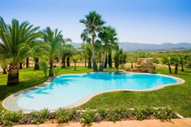 Superb luxury country villa in Javea, Costa Blanca, with oasis pool in over 1 acre of grounds just 10 minutes from the beach and WIFI.  Located in Javea´s countryside, Villa Quimera is ideal for those seeking total privacy and tranquillity yet is a short drive to Javea´s beach, restaurants and cafés. The outdoor space is spectacular, with a fabulous beach entrance Ibiza-style pool, a summer kitchen and outdoor dining area, large BBQ, and a spacious chill-out terrace for after dinner drinks. It is set in large grounds and is completely private. Inside the property continues to wow! Stylishly furnished, the property has a main house and annexe. The main house has 4 bedrooms (3 doubles and 1 twin) each with air-conditioning, there is one shower room downstairs and one bathroom upstairs. The separate annexe is accessed from outside and has an air-conditioned bedroom and bathroom ensuite. La Sella Golf Course is a 7 minute drive away, Javea´s old town just 5 minutes and the Arenal Beach 10 minutes by car. There are restaurants and small supermarket locally. , Javea