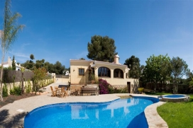 Children's favourite! Sunny holiday home with WIFI in Javea, Costa Blanca for 6 people. Villa Isabel is a 3 bedroom modern villa on one level in a quiet residential area, within walking distance of several restaurants and tennis courts.  The garden area around the pool is flat and so is ideal for families with young children. Children love the beach-style entrance to the main pool and their own special separate pool. Meanwhile, you can relax and keep an eye on them from the terrace. The sandy Arenal beach is just 5 km away with shops, restaurants and cafes. , Javea