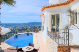 Luxury 2 level Villa in Javea, Costa Blanca, Spain, ideal for a maximum of 8 persons with private pool and wonderful panoramic views 180º to the sea, valley and village.Due to its elevated position, nestled at the foothills of the Montgo, this impressive Villa enjoys magnificent views of the valley and the Mediterranean sea right down to Javeas coastline. It is situated near the Port as well as Javea beach. Behind the villa you can find the Montgo´s Nature reserve. The house offers privacy, to enjoy an undisturbed holiday with the whole family and take pleasure in the breathtaking views from the huge covered terrace. Its tranquility, comfort and short drive to the beach, make this an ideal Villa to spend your holidays with family or friends and even your pets. Main level, Javea