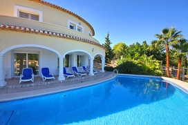 Amazing villa  with private pool in Javea, on the Costa Blanca, Spain for 8 persons.  The villa is situated in a lovely wooded residential area. This location offers an easy drive down to the El Arenal boulevard for shopping, dining and entertainment, Javea