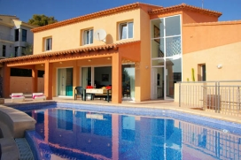 Fantastic holiday rental villa of modern style with seaview and situated in El Portet of Moraira with capacity for maximum of 10 people. Of recent construction, with air conditioning in the five bedrooms and in the lounge - dining room., Moraira