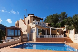 Traditional style family villa located on a hill in Cala Moli area, enjoying breathtaking views over the sea, the islands and some of the west coast. Surrounded by a pine wood and Mediterranean vegetation, the villa enjoys numerous outdoor spaces on , Cala Moli