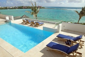Le Bleu is simply the most exciting and glamorous new villa in Anguilla (opened December 09).  This 10 bedroom villa (all en-suite) is located in approximately 2.5 acres of beautiful tropical gardens with two swimming pools, two small natural be, Little Harbour Estates